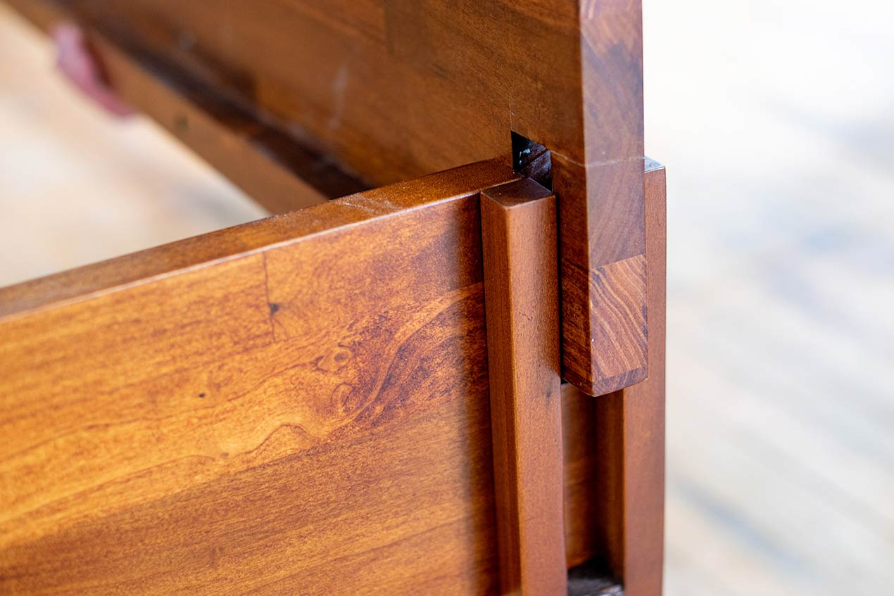 Close up assembly of Rustic bed frame.