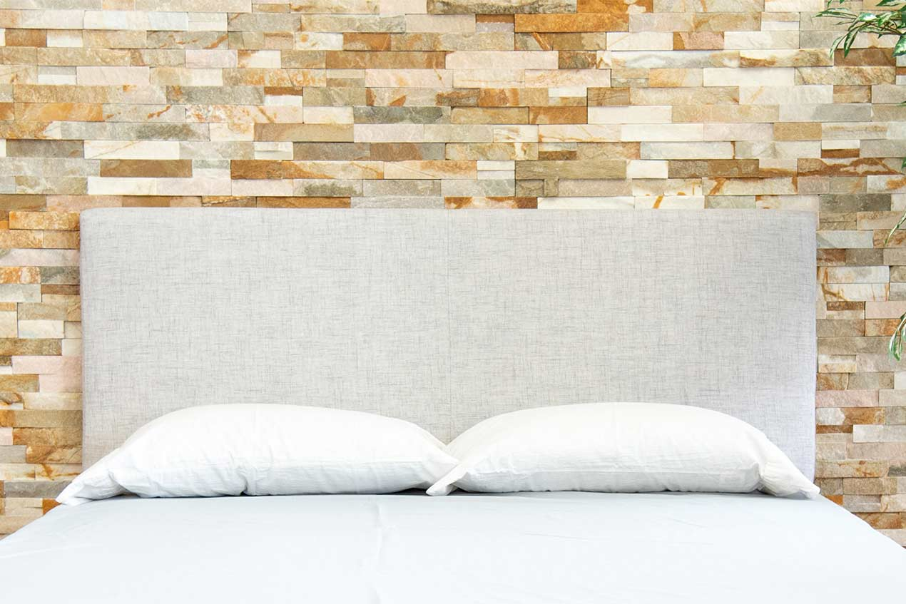 A great Rustic headboard on bed frame.