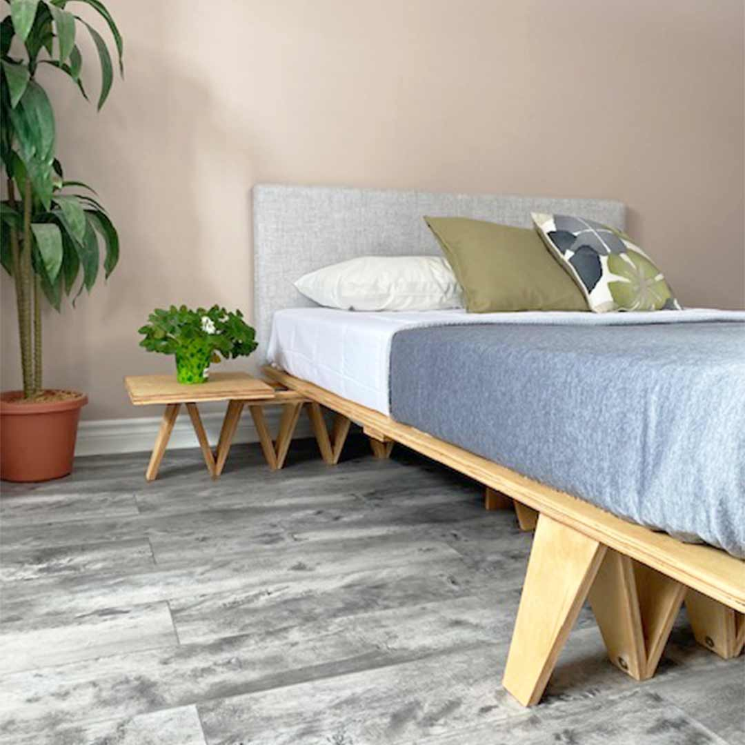 Flex bed frame in bedroom with mattress and pillows.