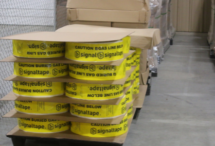 rolls of yellow marker tape with signaltape writing