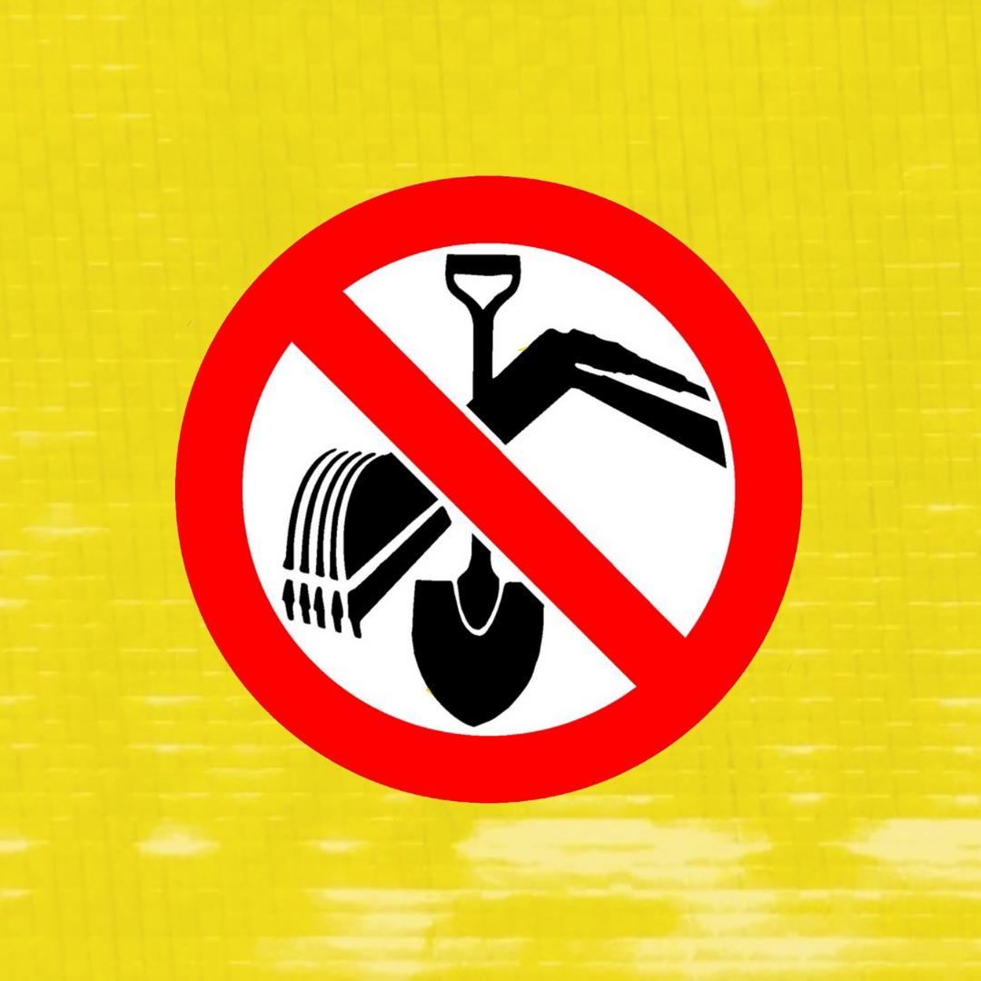 yellow hazard tape with no dig symbol