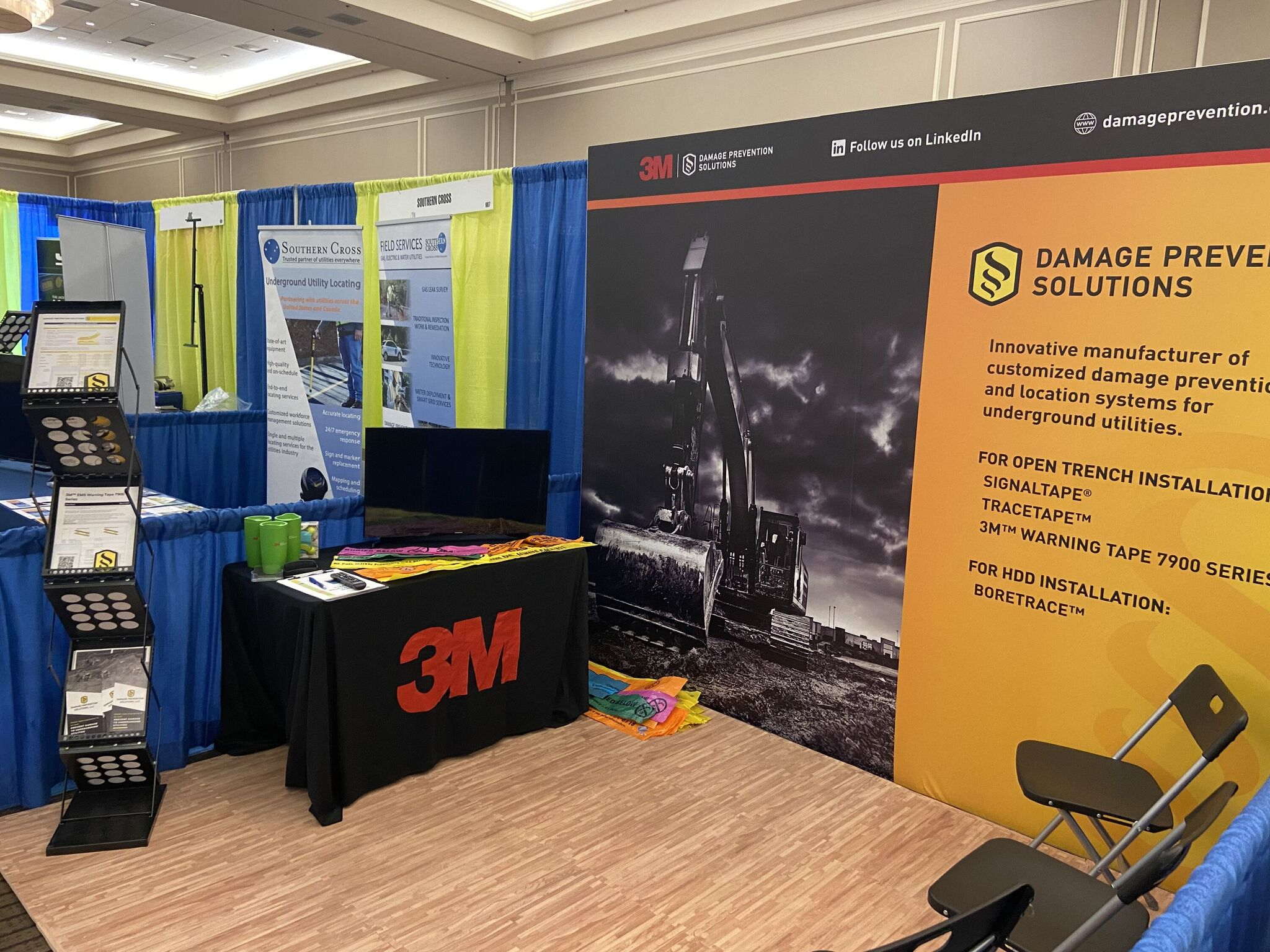 Damage Prevention Solutions booth display with underground warning tape and underground marker tape