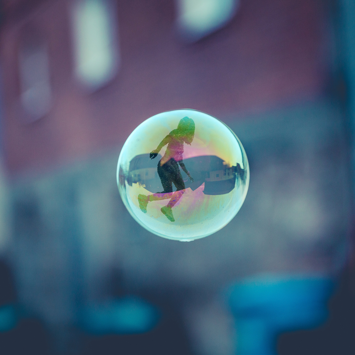 Girl reflection in bubble