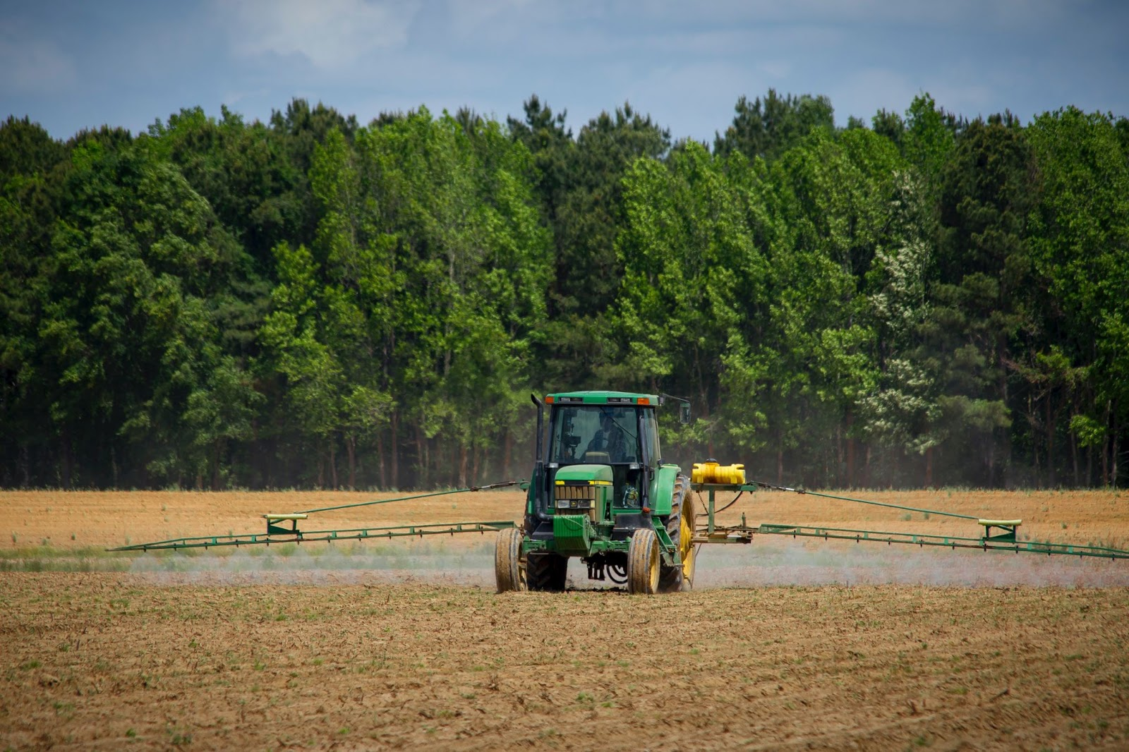 a tractor operating on a field