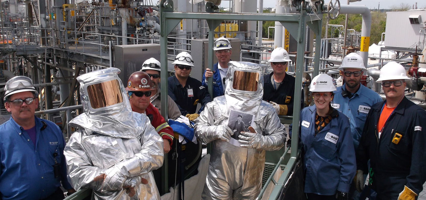 Phoenix Crew Posing for Photo at Chemical Plant