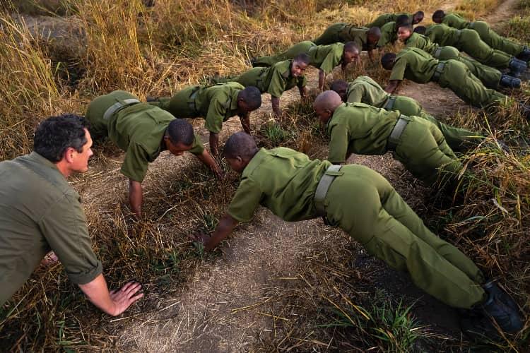 Akashinga Rangers training doing press ups led by Damien Mander