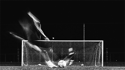 time-lapse of a soccer player scoring a goal.