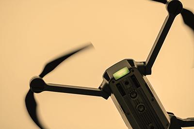 black drone in the fog-like sky.