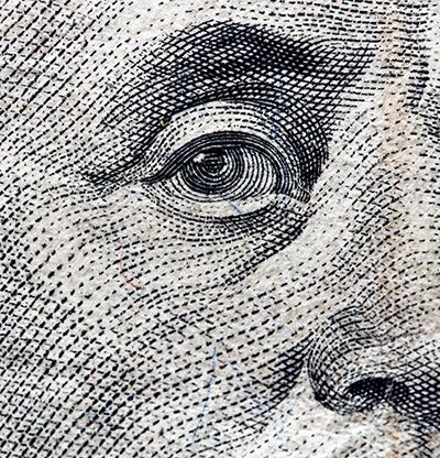 eye of benjamin franklin on the USD100 bill.