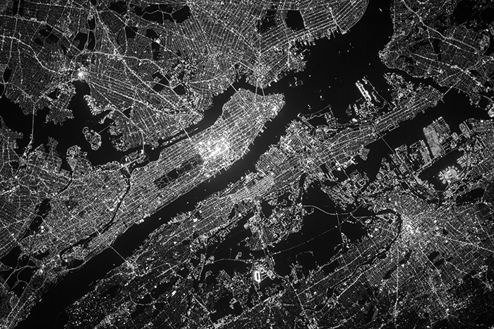 satellite view of earth surface, particularly the city lights of Manhattan.