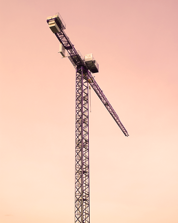 A stand-alone construction crane supporting a urban renewal project in Be'er Sheva, Israel.