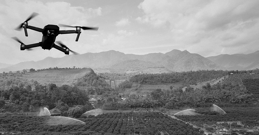 agtech drone flying over an orange grove to collect data analytics