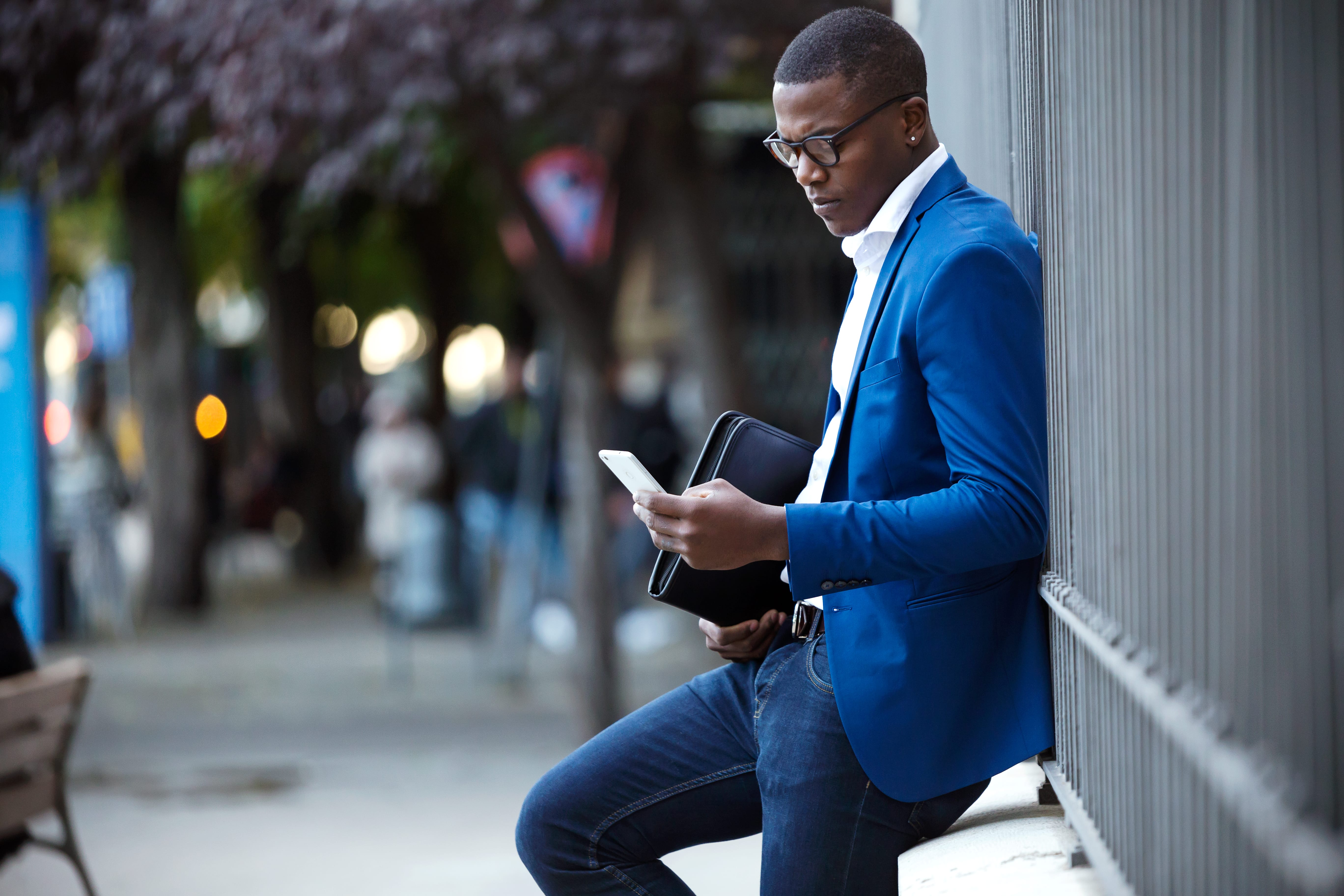 young business man texting from cellphone