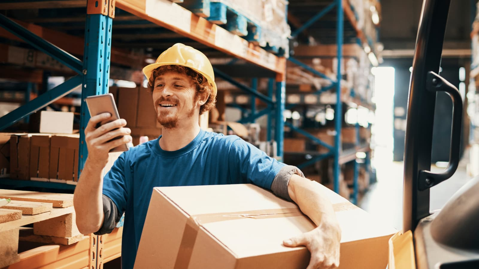 Recall InfoLink recall responder looking at a phone in a warehouse