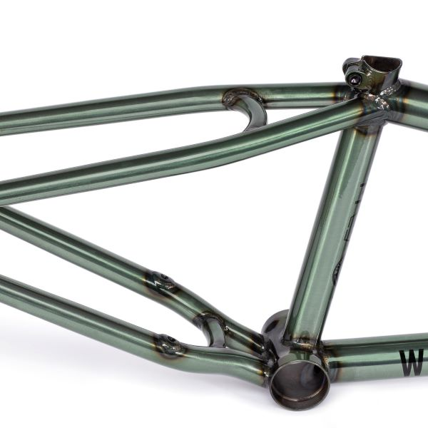 WE LOWERED THE CHAINSTAY TO MAKE EXTRA ROOM FOR CHAINSTAY MOUNTED BRAKES WITH SMALLER GEARING WHILE INCREASING BRAKE POWER