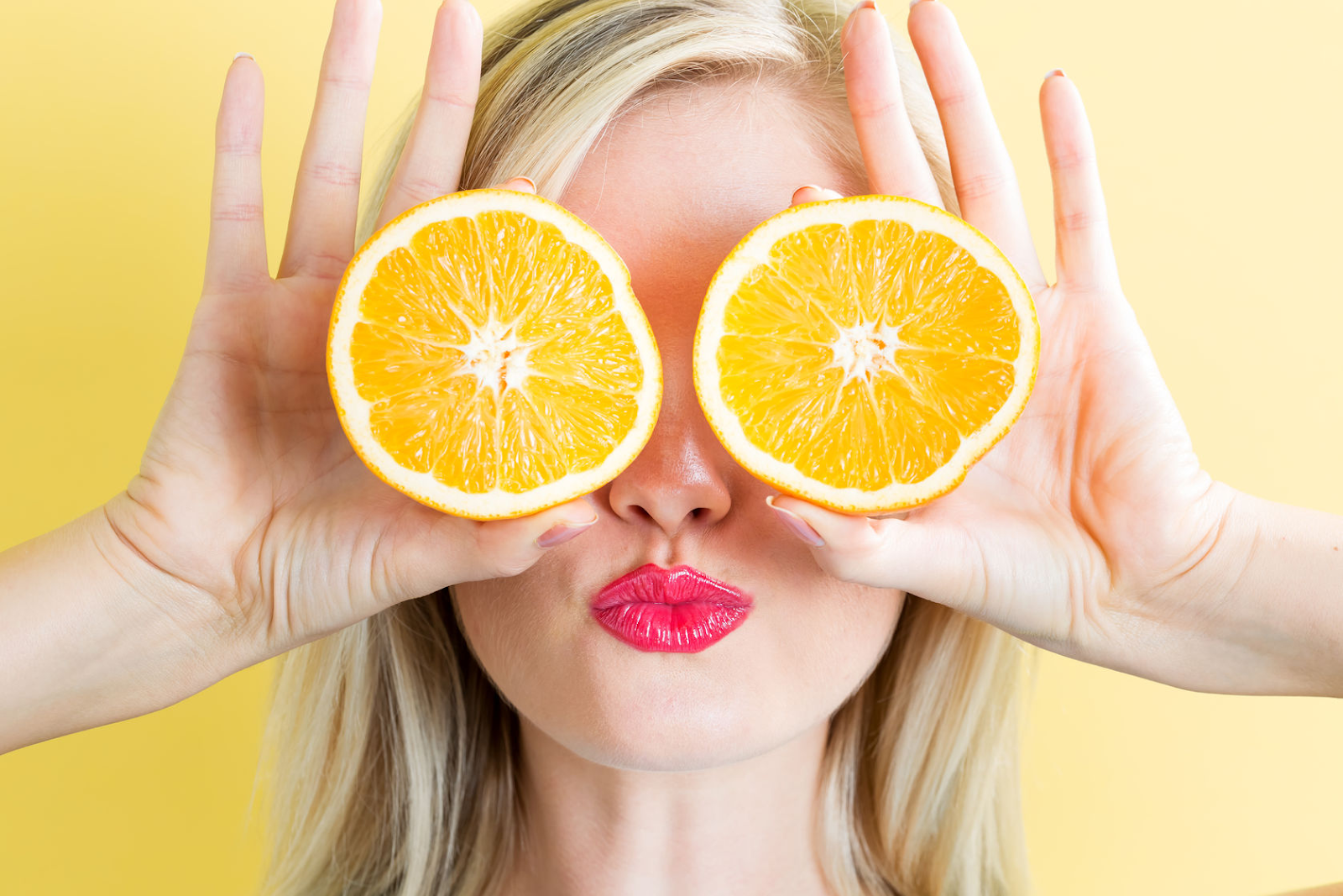 woman holding oranges