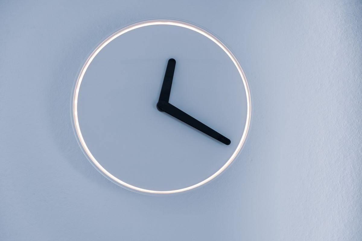 Minimalist Neon Clock on the Wall