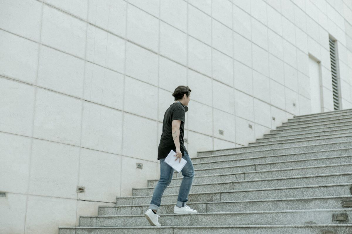 A Man Walking up Some Stairs