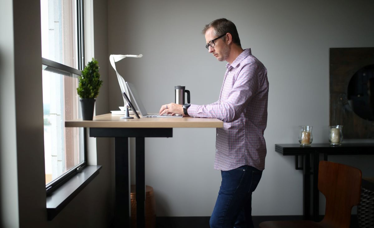 A Man Working at a Standing Desk