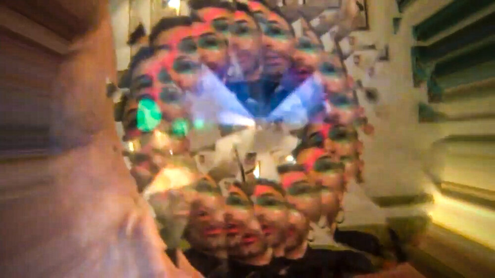 a blurry and bright image of a performer's face that looks like a kaleidoscope with colors and patterns