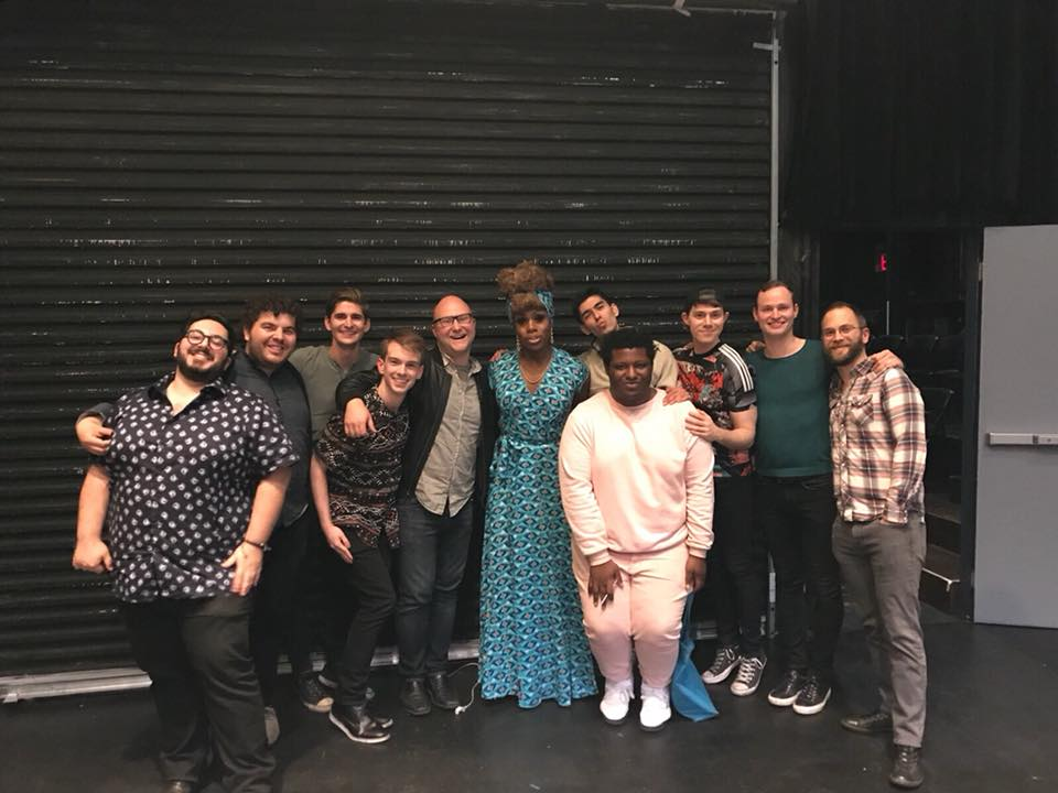actors posing in different stances in a group after la mama experiments play reading series