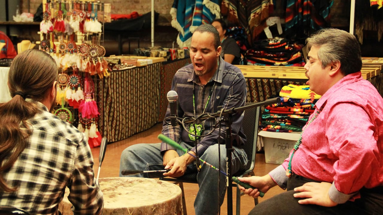 three performers drum and sing at the la mama indian market and social