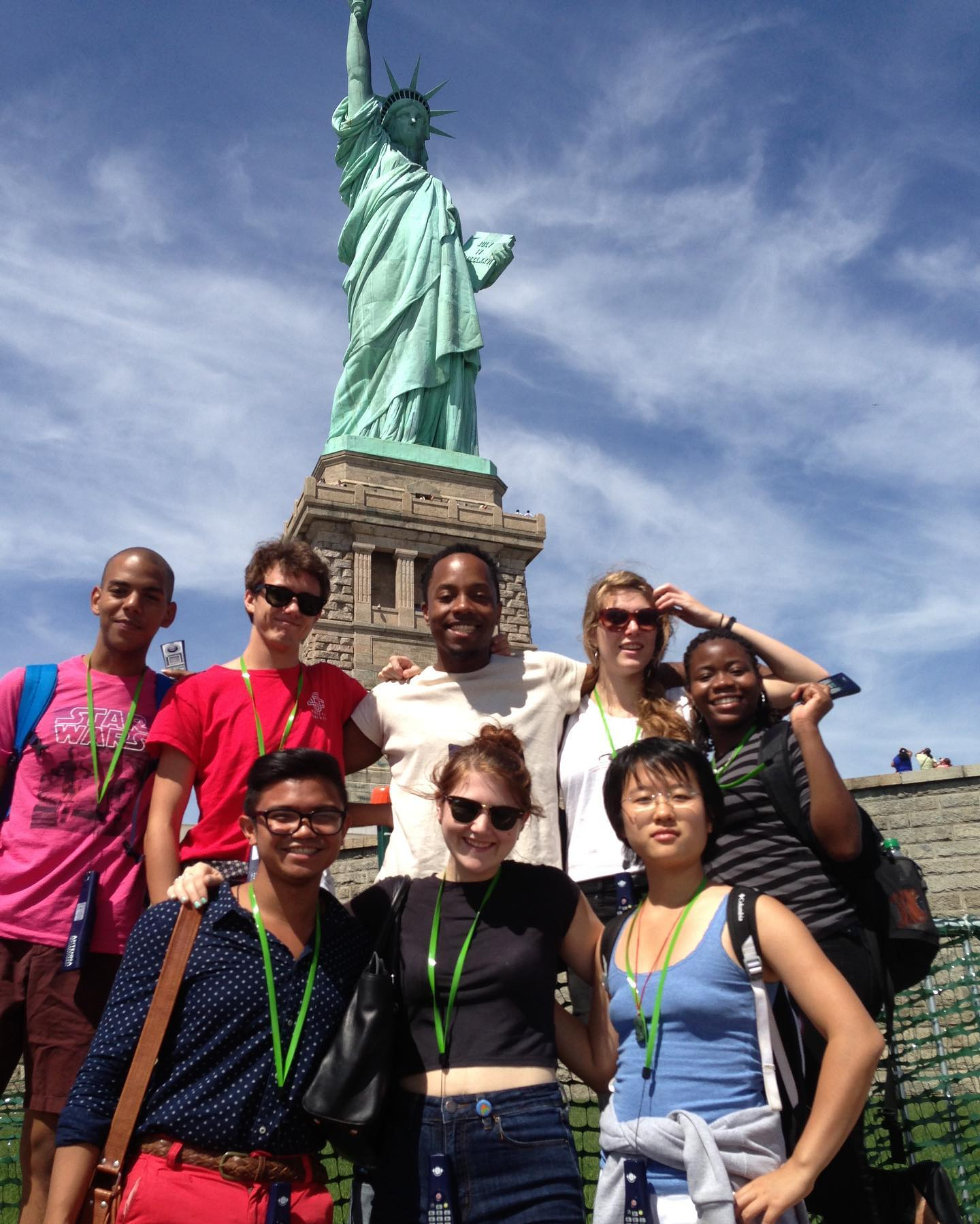 Trinity La MaMa students posing in a group at the Statue of Liberty