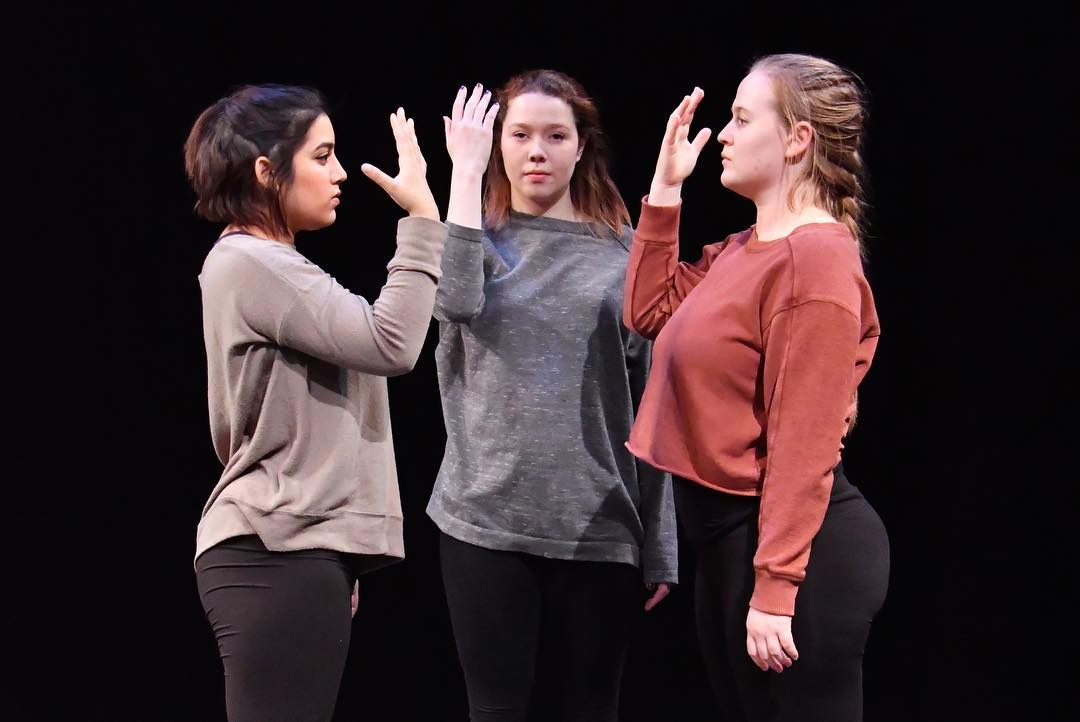 Trinity La MaMa students posing in a group on stage for a performance