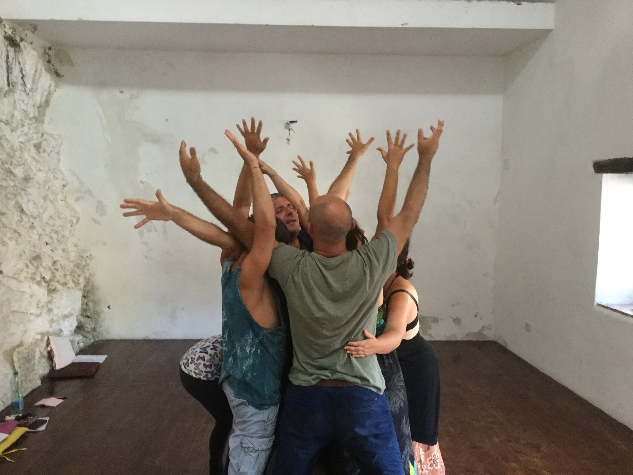 artists sit outside at La MaMa Umbria International working on movement in a gorgeous Umbrian sunlit room