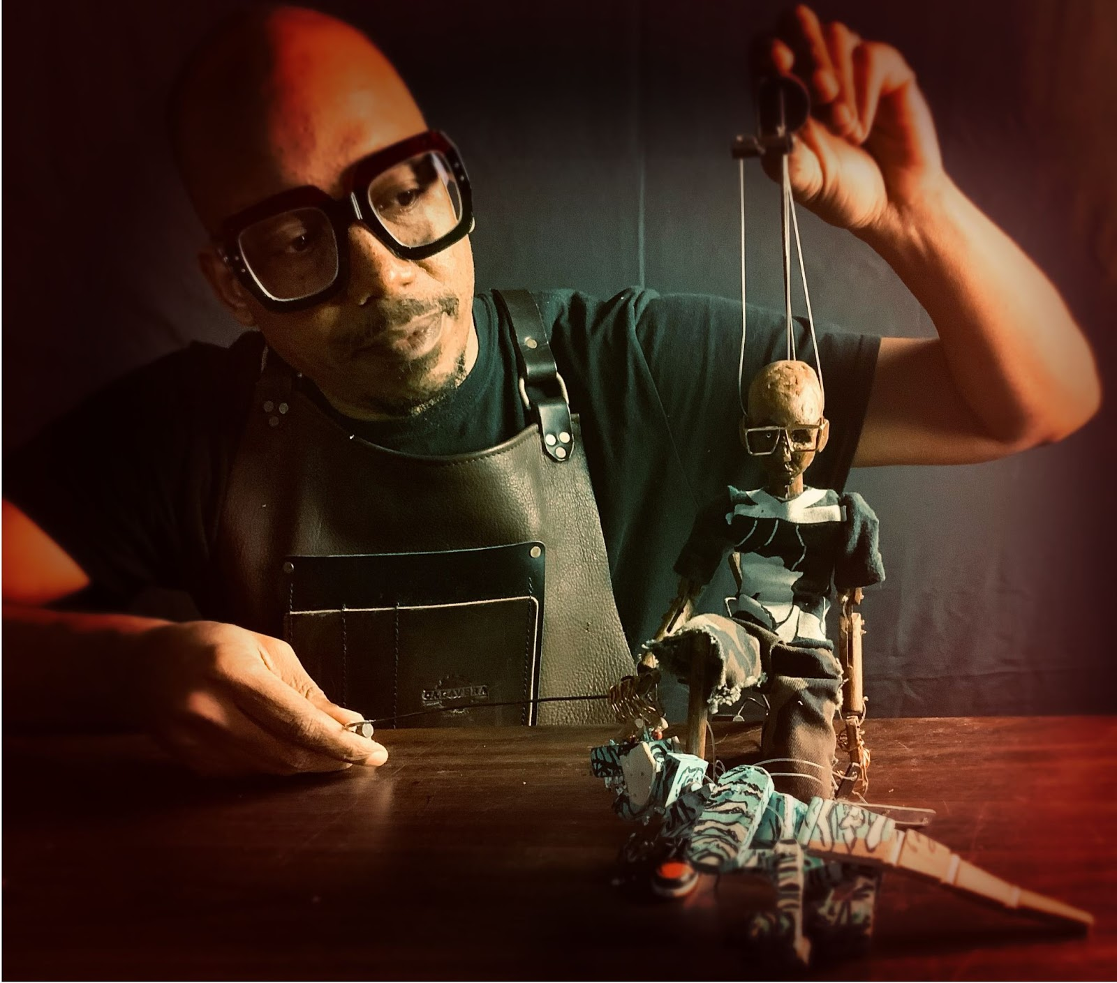 Tarish Pipkins holding a puppet in his hand