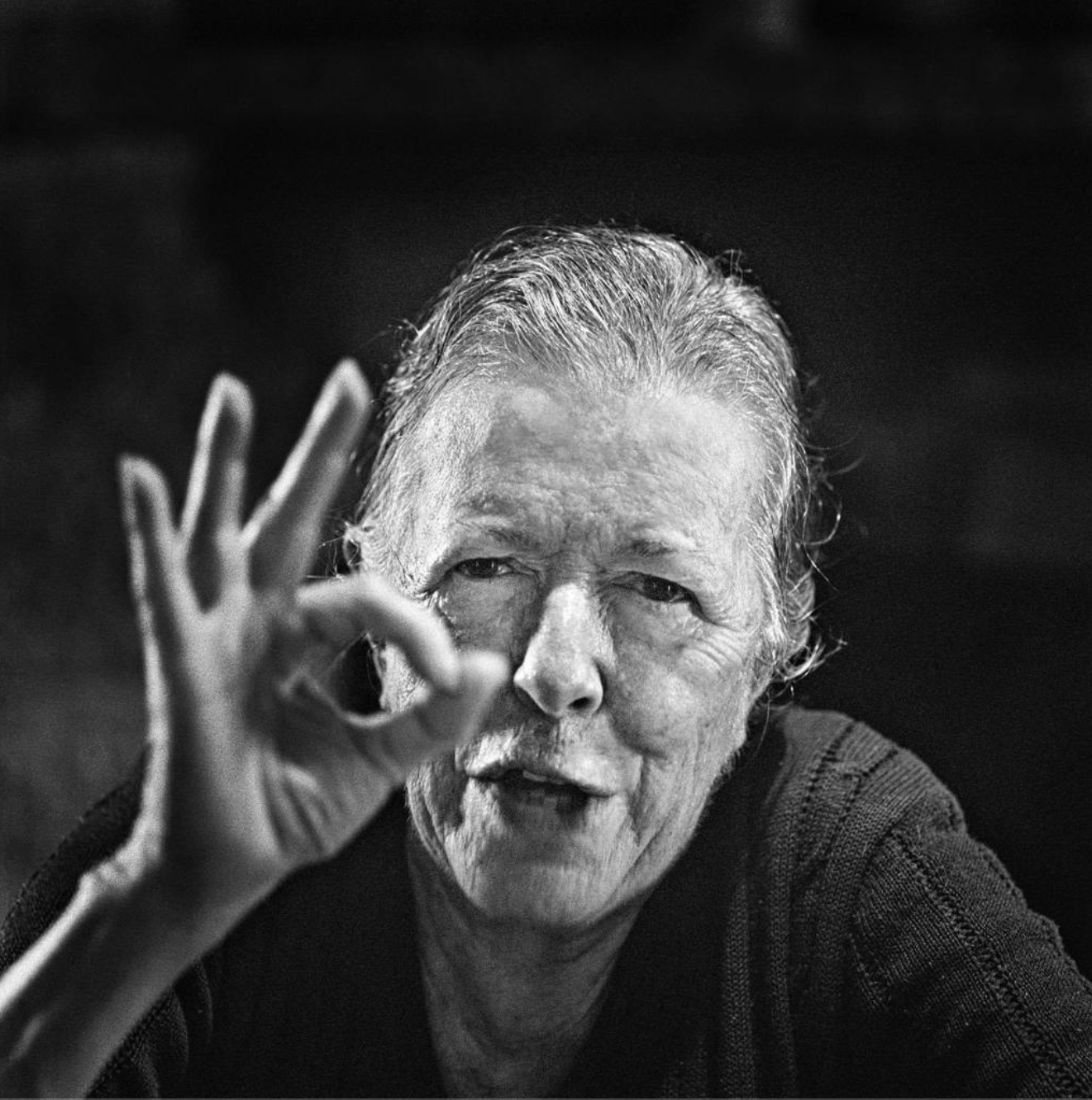 black and white photo of a woman holding up three fingers