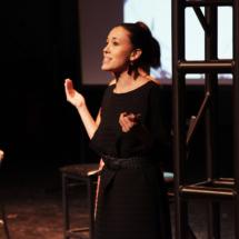 woman speaking onstage