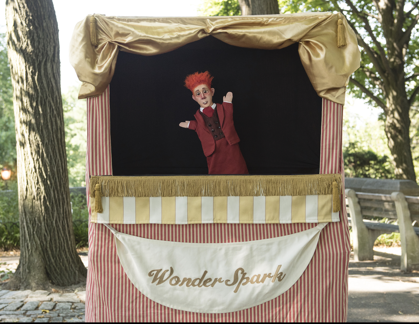 a red-haired puppet in a puppet theatre