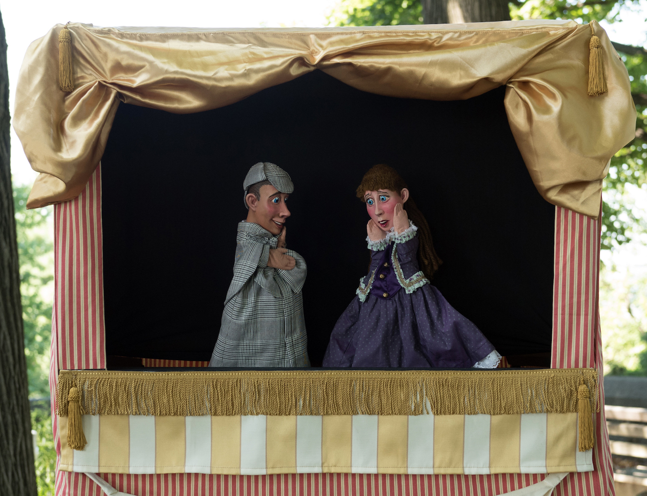 two puppets in a puppet theatre