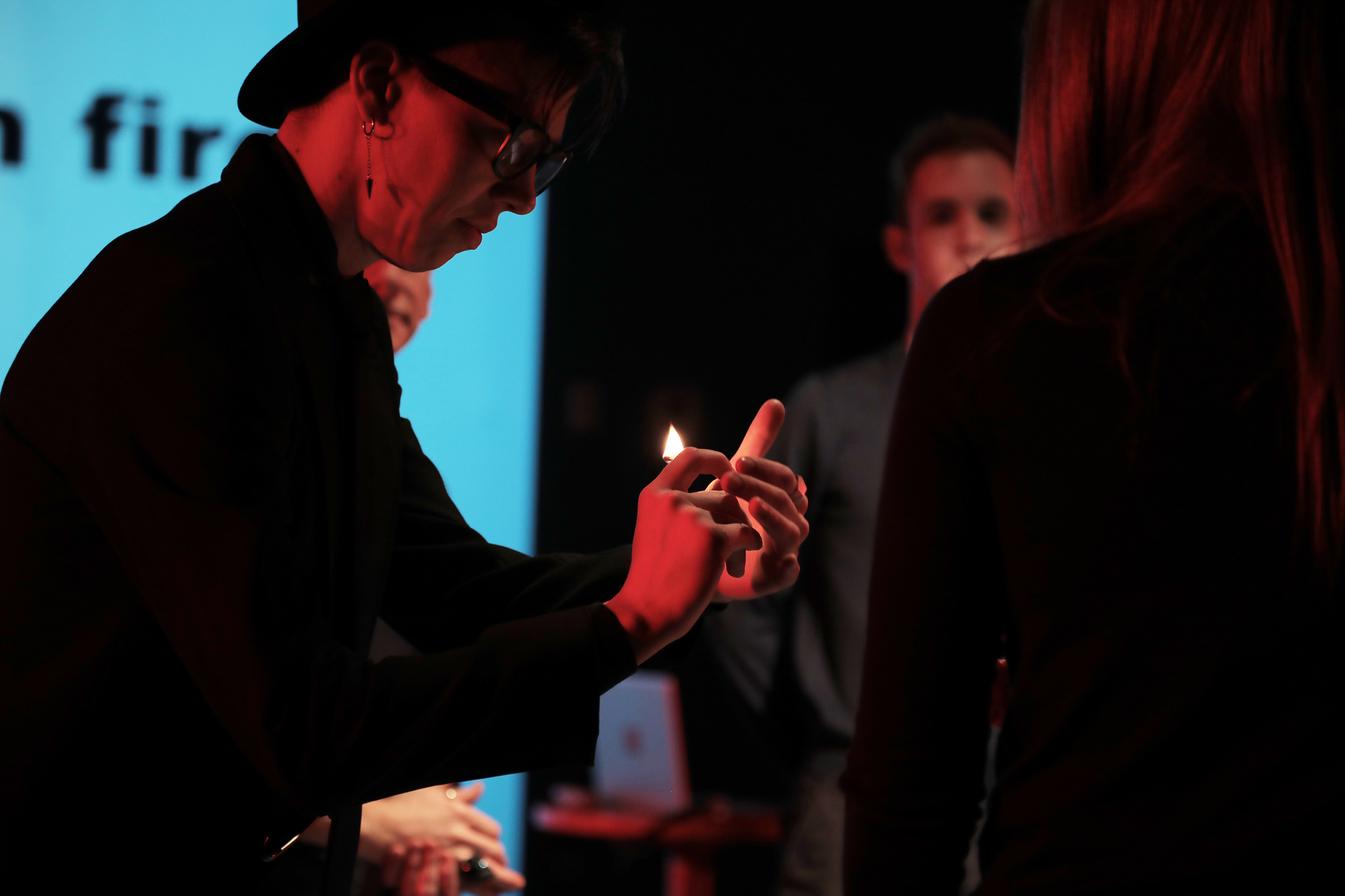 person holding a candle onstage