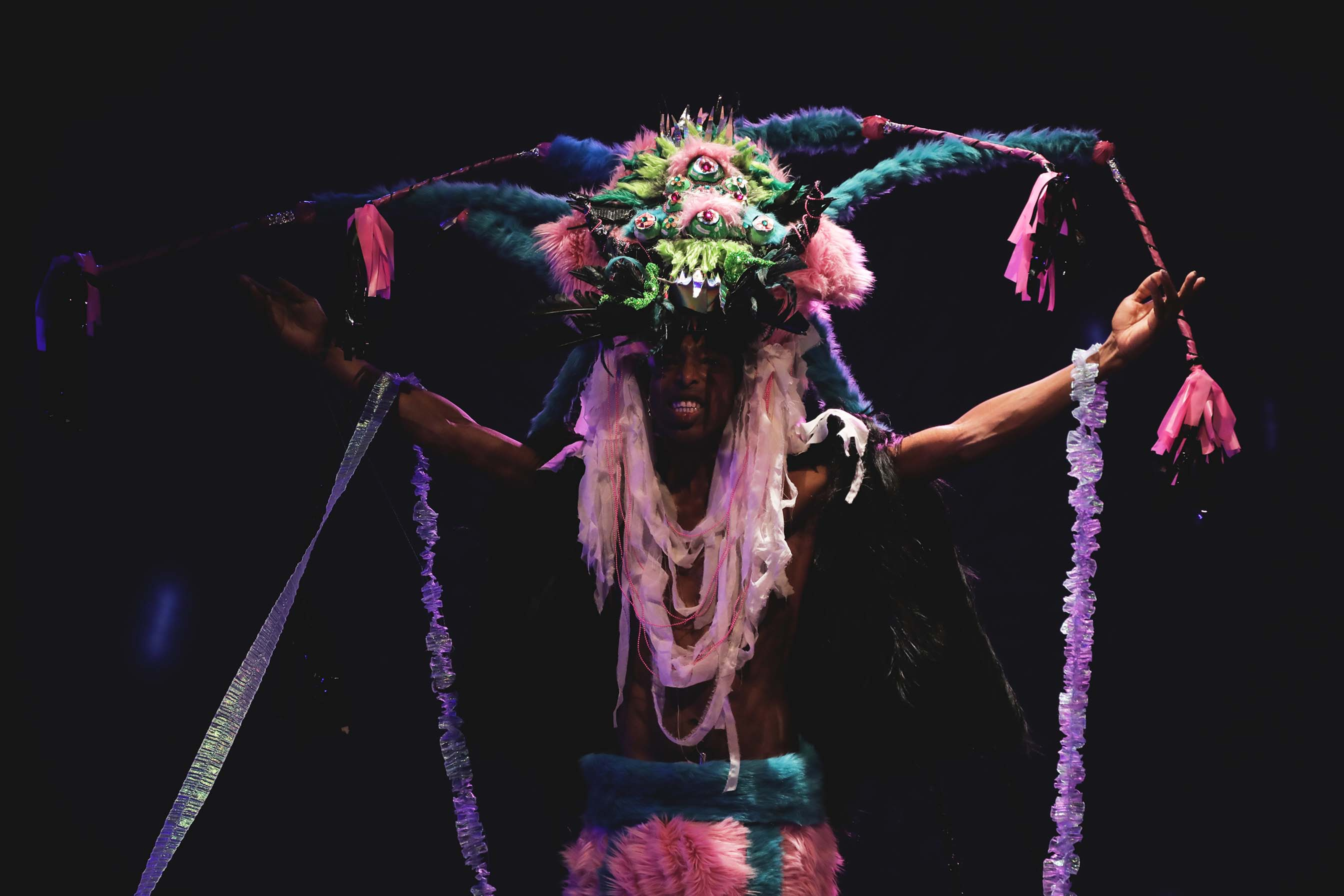 person wearing a colorful headpiece onstage