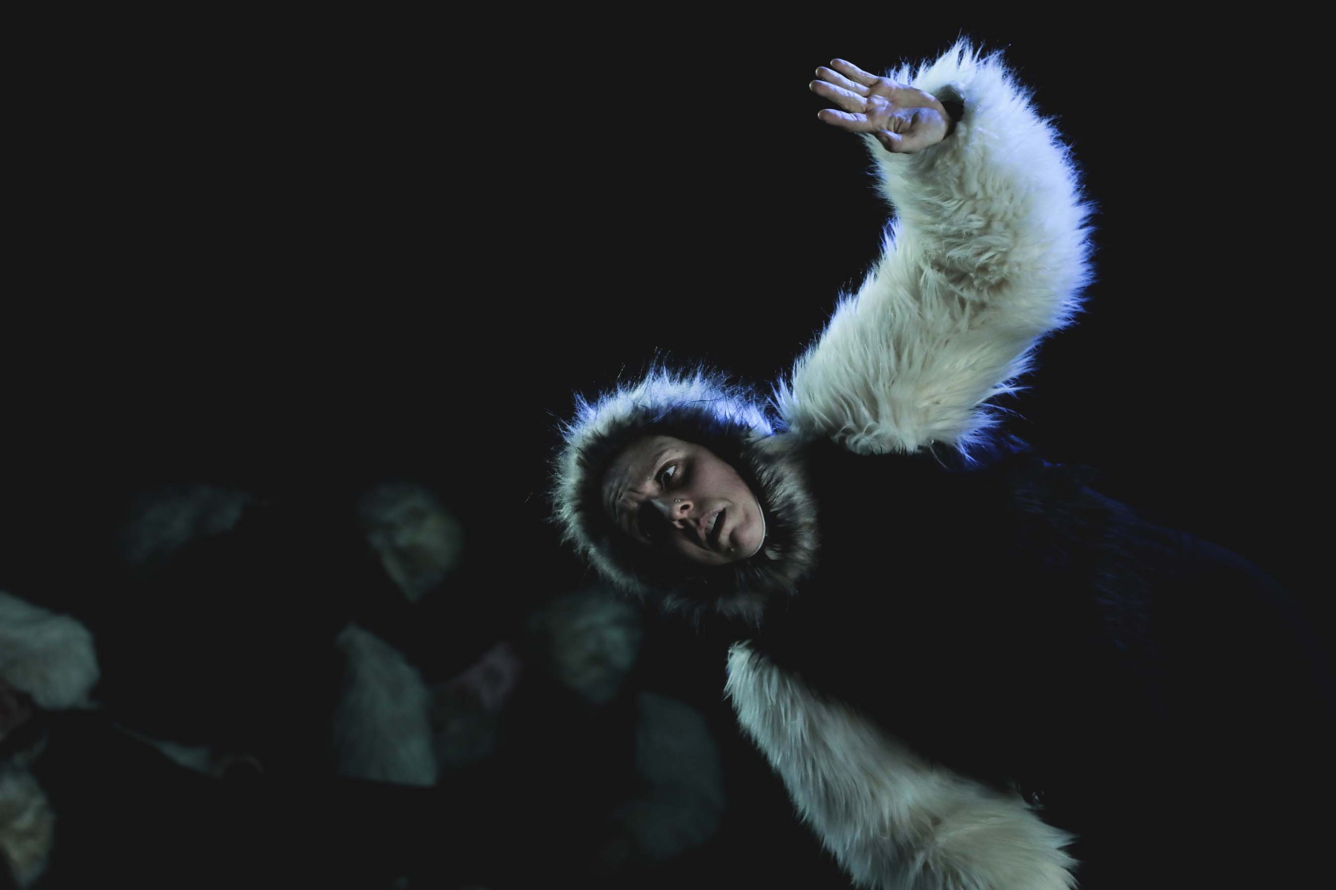 person wearing a white fur coat dancing