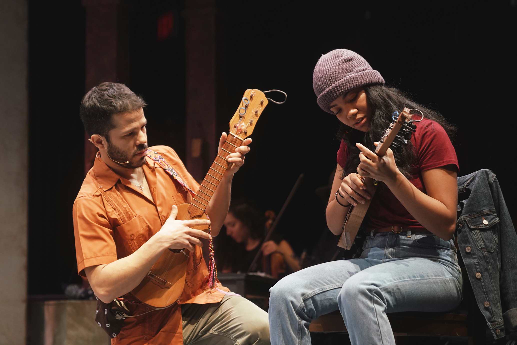 two people holding instruments