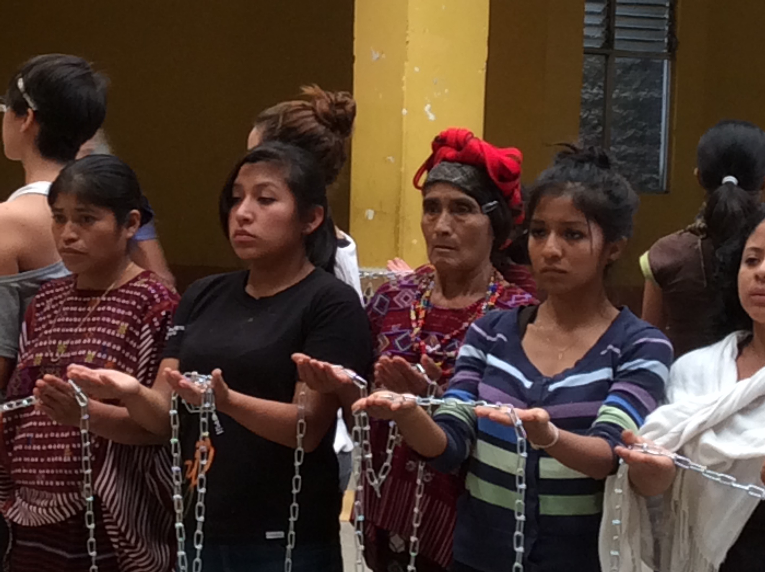 a line of people holding a chain