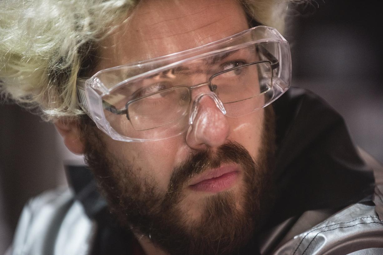 man waring lab goggles