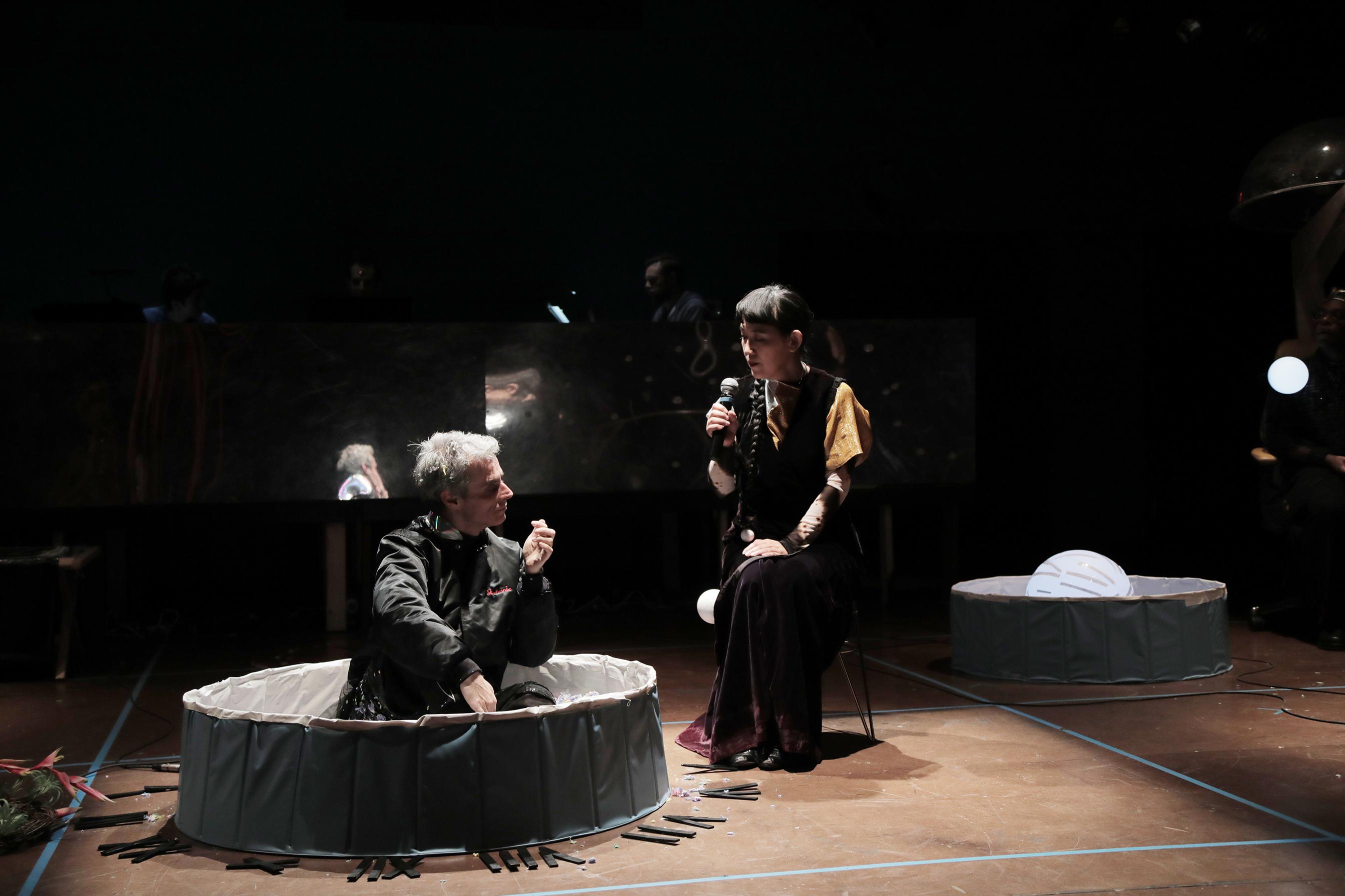 performers seated onstage