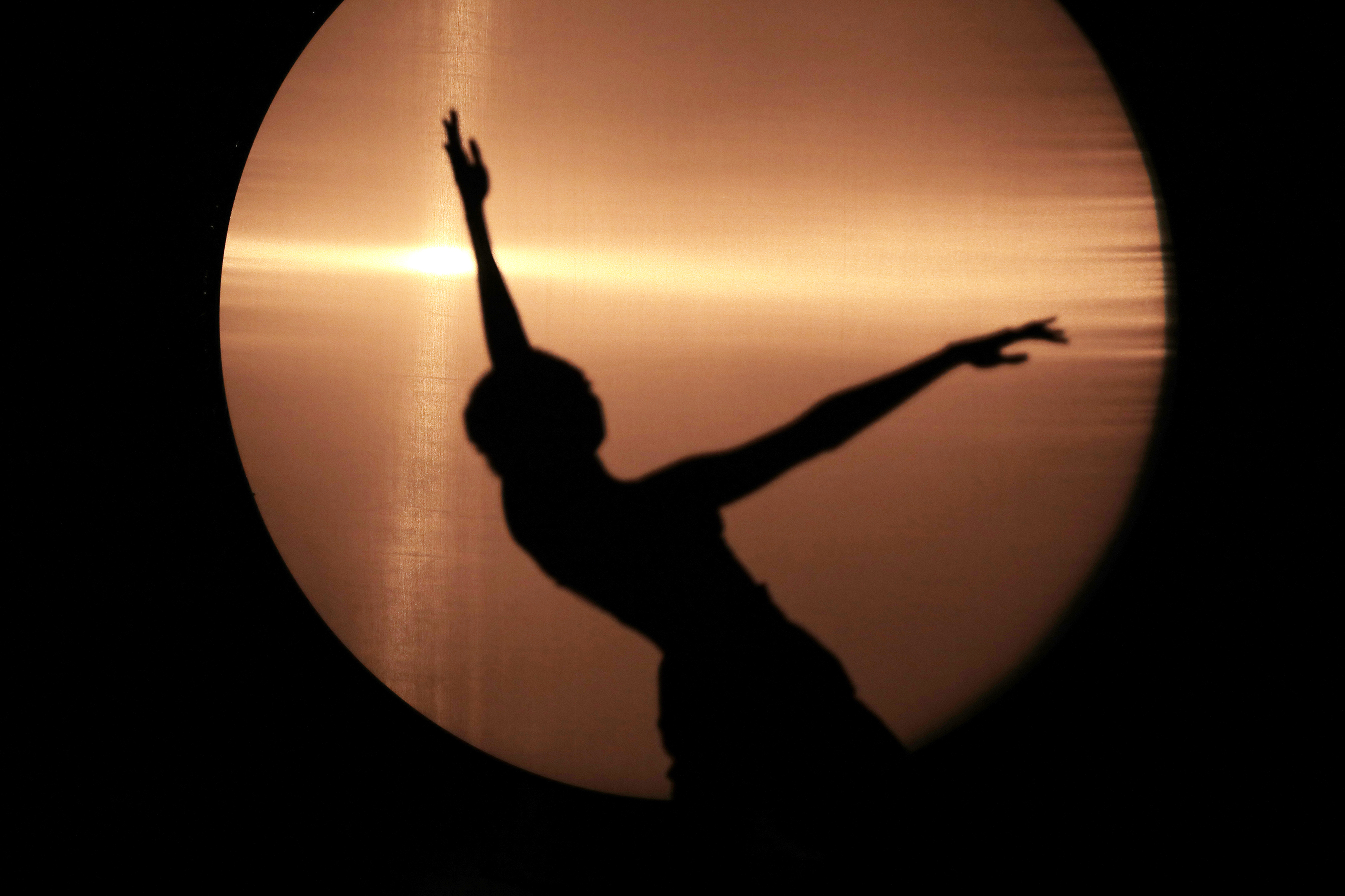silhouette of a dancer in front of a light