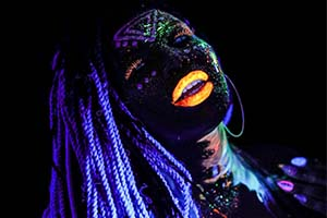 performer with neon paint