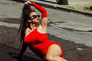 person wearing a red dress laying on the street