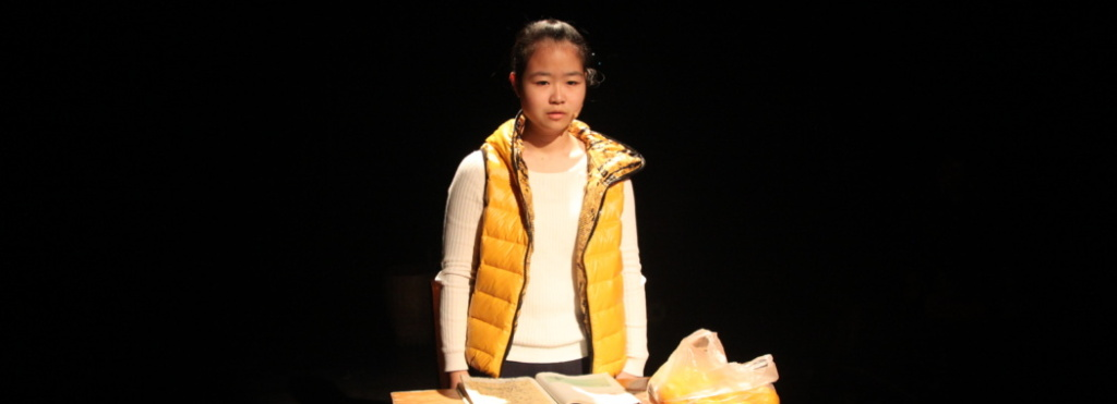 a performer wearing a yellow vest
