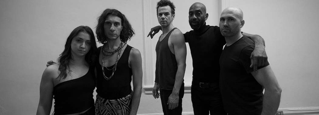 black and white photo of five performers for global gay