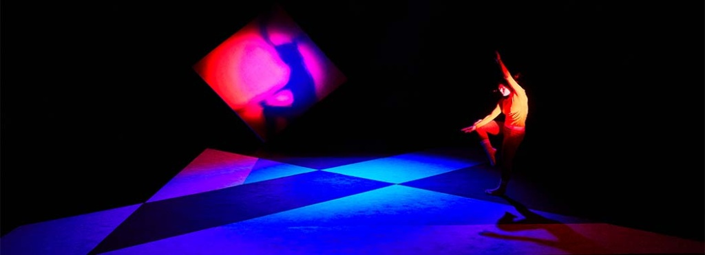 performer dancing in multi colored stage