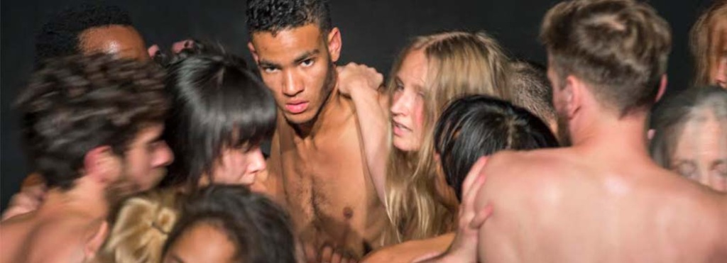 a group of shirtless people