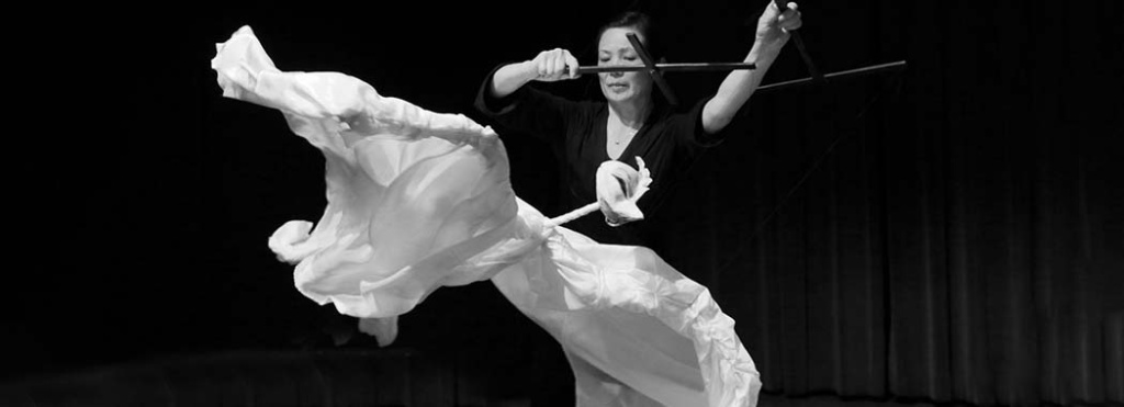 performer with white fabric