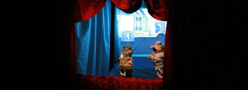 puppet in a small puppet theatre